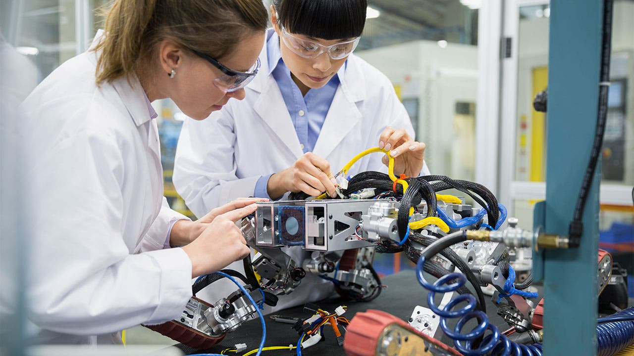 Scientists working on a robot in a lab