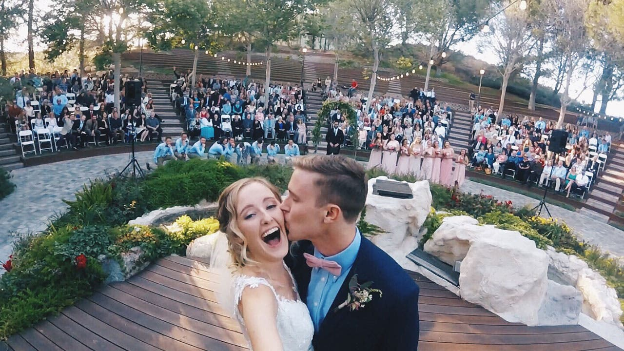 Couple doing a selfie at wedding