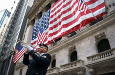 Military officer playing taps in front of NYSE