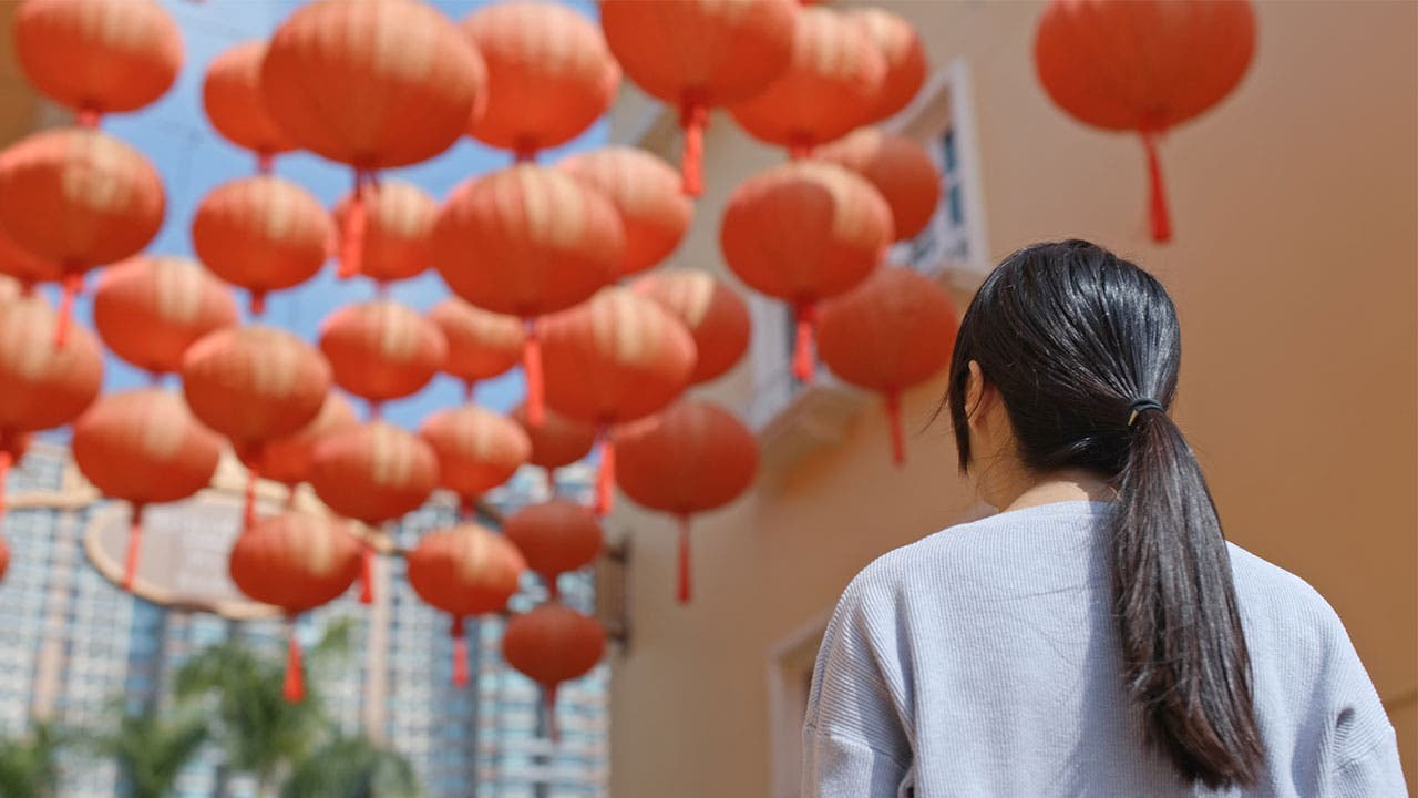 Woman with Chinese lanterns