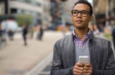 Man texting while walking