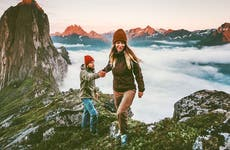 Couple on top on a mountain in Norway