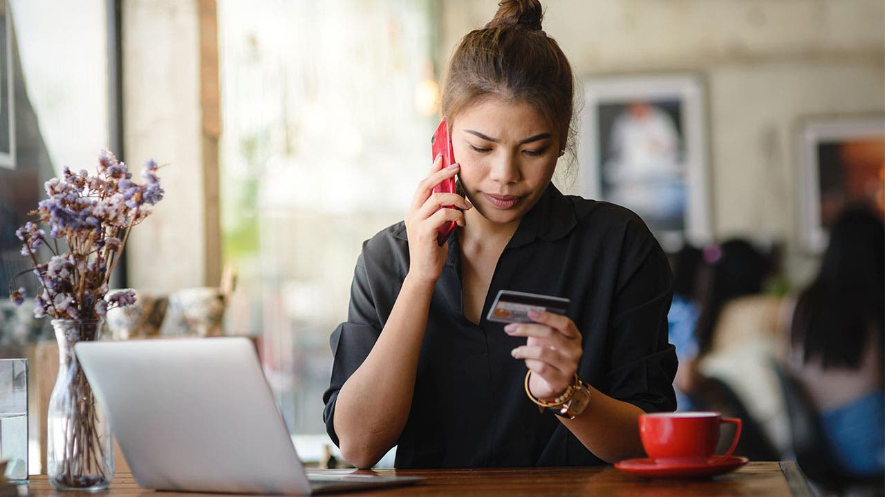 Woman on phone with credit card company