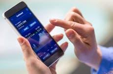Woman using phone to buy stocks