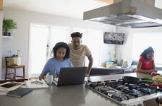 Couple working on finances in kitchen