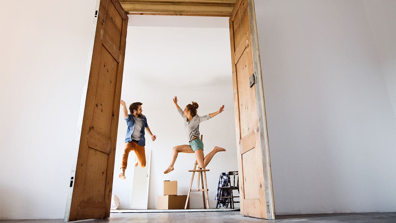 Millennials jumping after moving into apartment