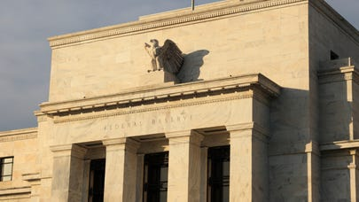 If the Fed cuts interest rates, expect it to be an 'insurance' cut — here's what that means