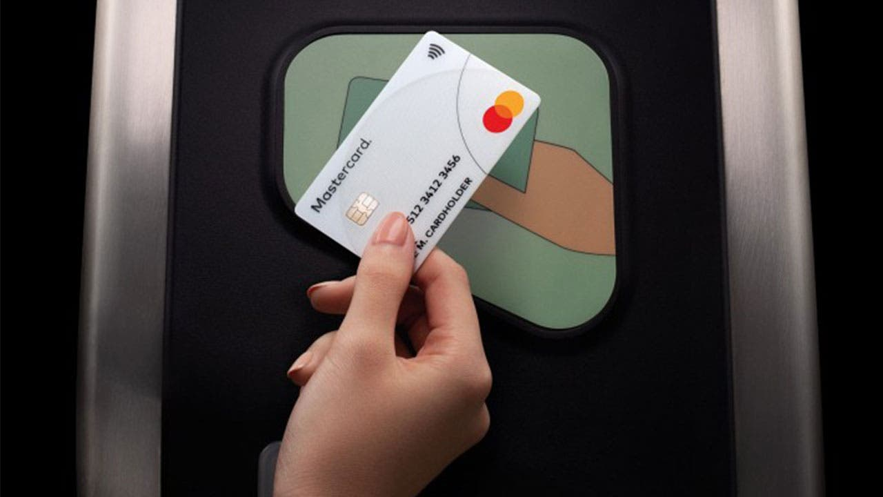 Woman using contactless Mastercard