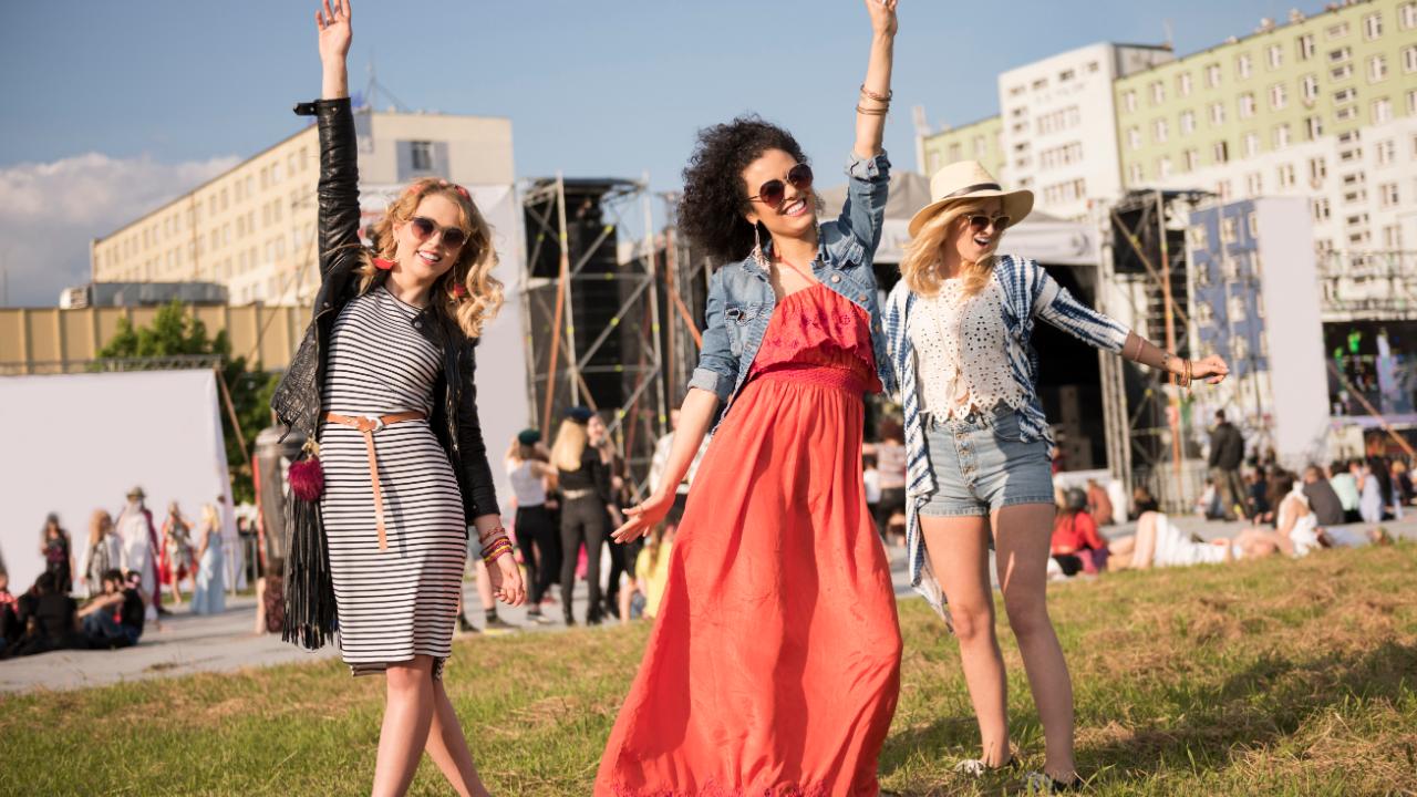 Women dancing at music festival