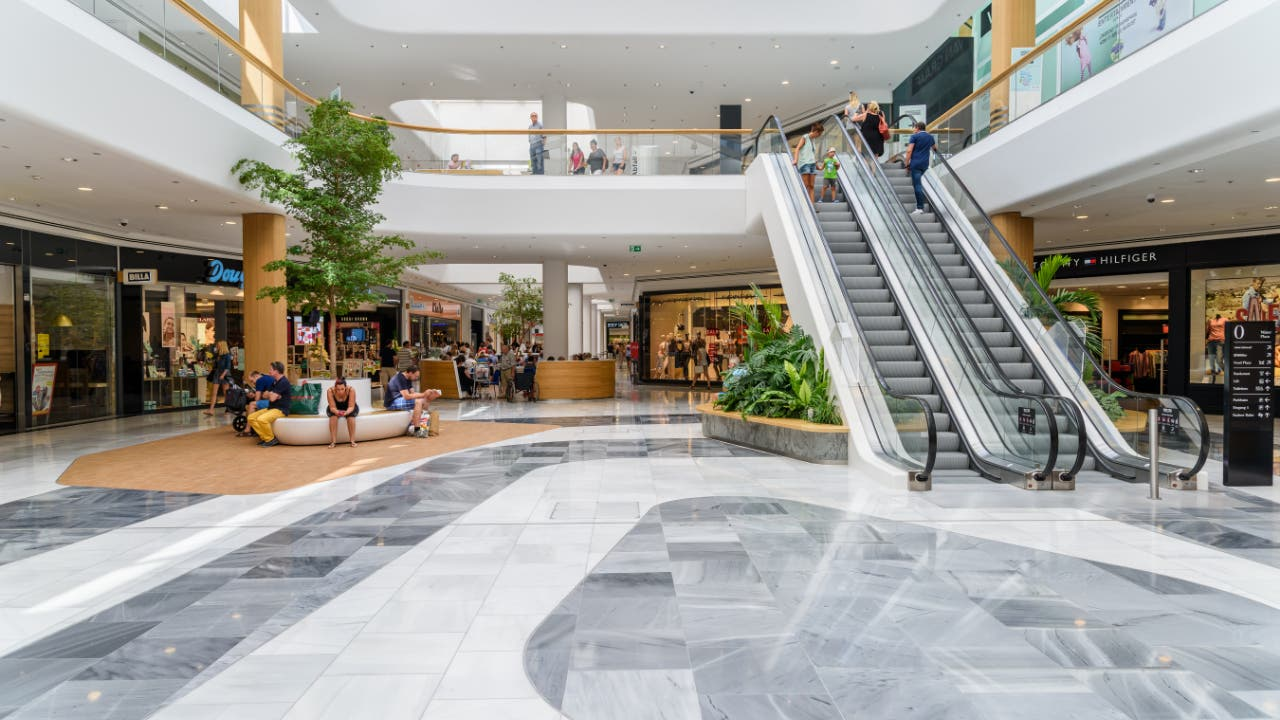 An indoor mall with people shopping
