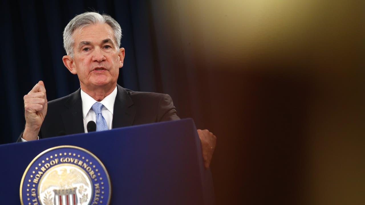Federal Reserve Chairman Jerome Powell speaks to journalists at a news conference following the Fed's June 19 interest rate decision.