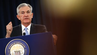 Fed cuts interest rates by a quarter point for the first time in a decade