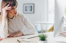 Woman looking at computer, troubled