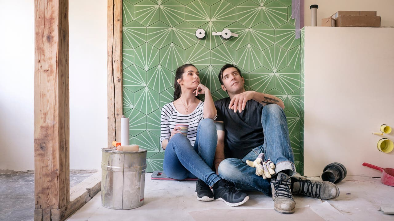 Couple pondering home renovation