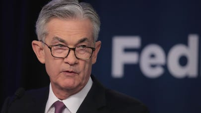 Fed's Powell signals a rate cut, cautions on downside risks to economy