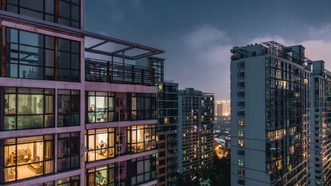 A picture of modern apartment buildings at twilight
