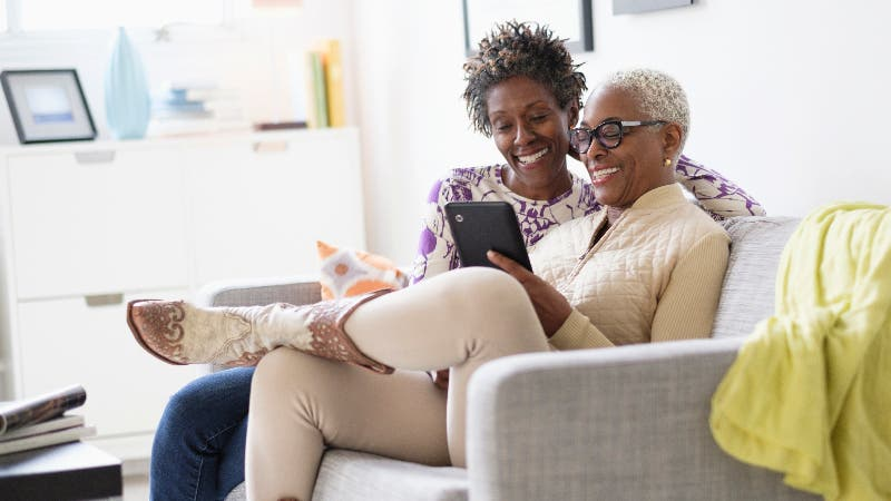 Black couple looking at tablet