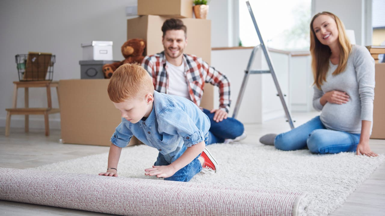 Family unpacking in a home