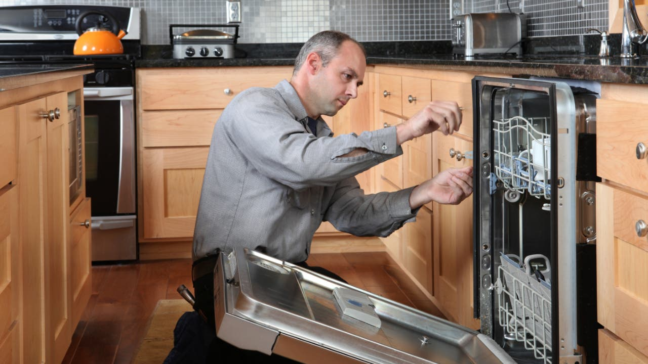 A technician fixing an appliance