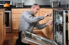 A technician fixing an appliance