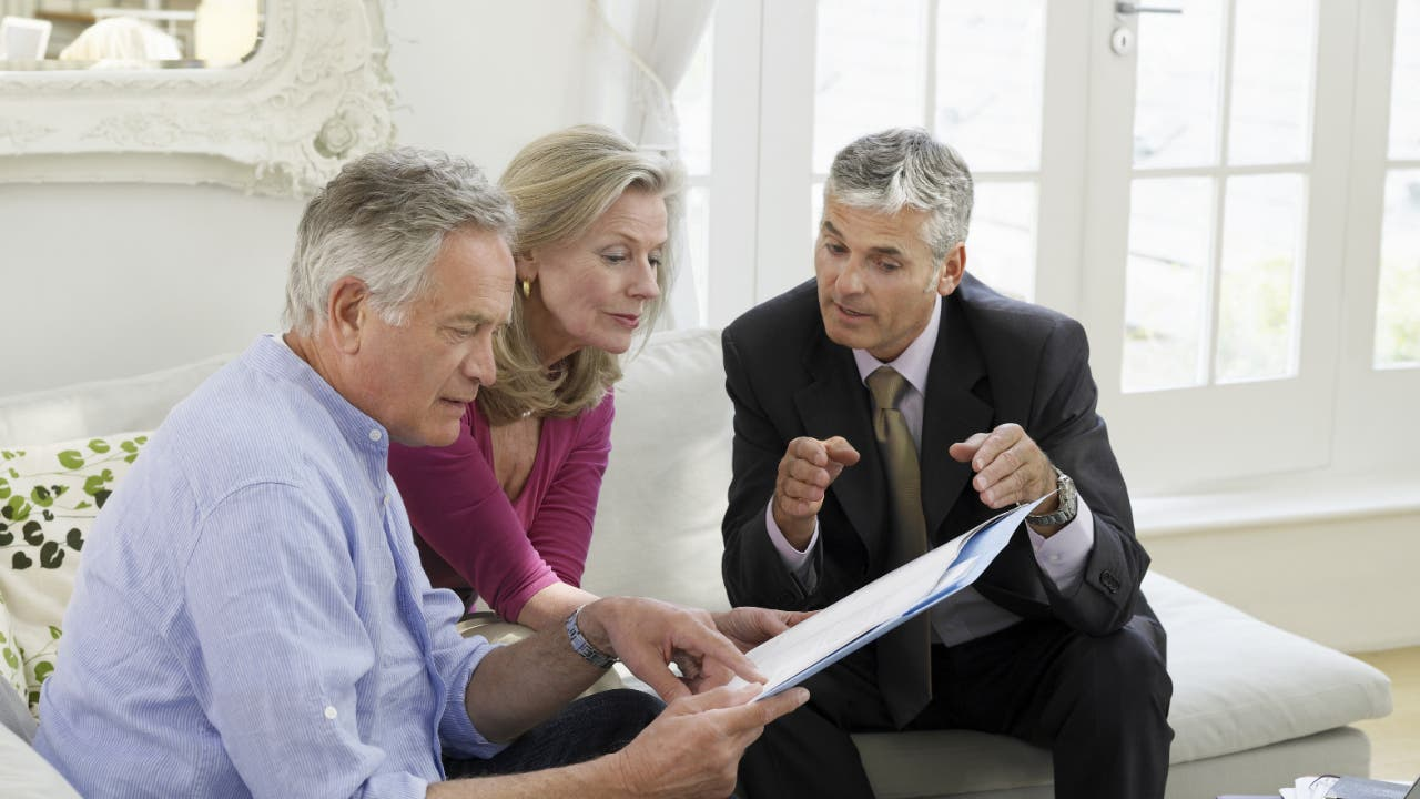 An adviser consults an older couple about retirement