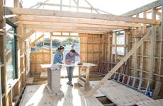 Couple working together to build themselves a new wood framed home.