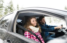 Young couple on a road trip in winter landscape