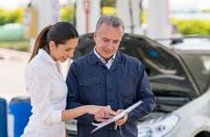 woman talking to mechanic, amica insurance