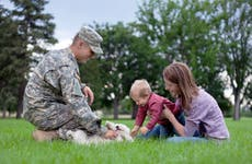 soldier with family and dog