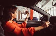 woman receiving key for rental car