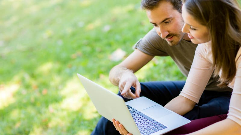 Couple outside with laptop