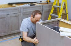 Man works on remodeling a kitchen