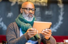 Man using tablet in coffee shop