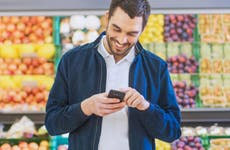 Man using phone at grocery store