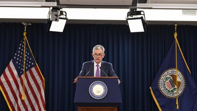 Fed cuts rates by quarter point, split on further reductions