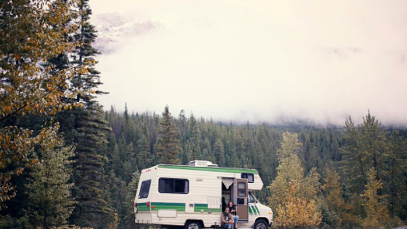 Coupe traveling in an RV among the mountains