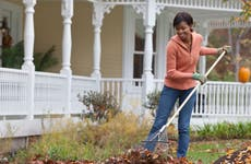 Woman raking leaves during the fall