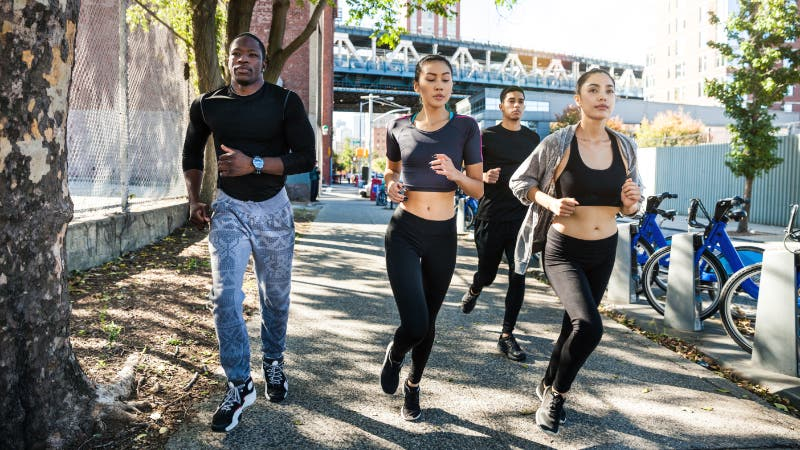 Group of people running in New York City.
