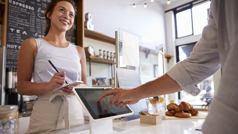 customer making a credit card transaction at merchant counter