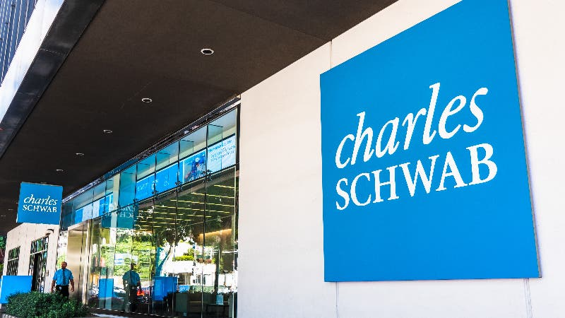 A picture of a Charles Schwab office and logo