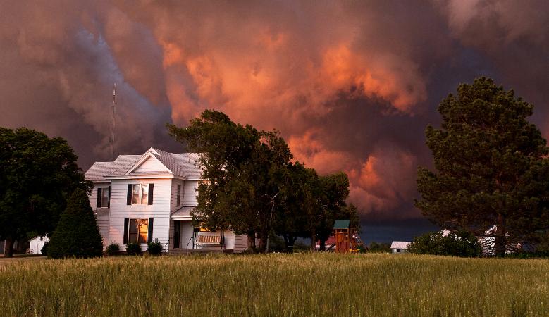 Storm clouds over house, Kansas, USA