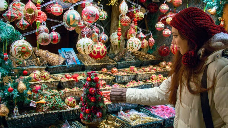 A woman shopping during the holiday season.