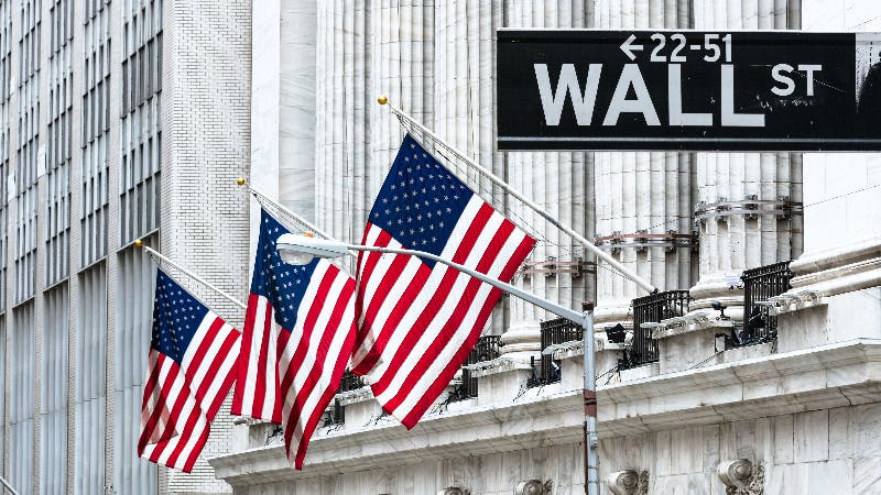 US flags fly outside the NYSE building on Wall Street