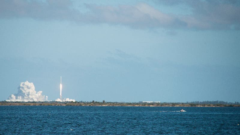 A rocket ship is launched near the water