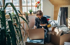 Woman moving in into new apartment
