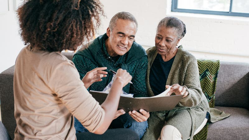 An adviser discusses inheritance with an older married couple