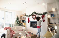 Woman hanging holiday decorations