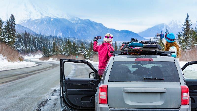 Woman driving car in alaska