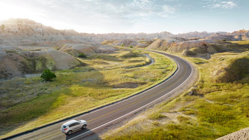 SUV driving through Bandlands National PArk