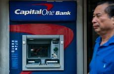 Man walking by ATM.